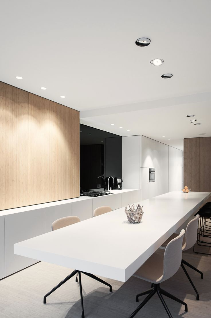 // Kitchen and dining // Mix of wood grain laminate cupboards and white laminate…