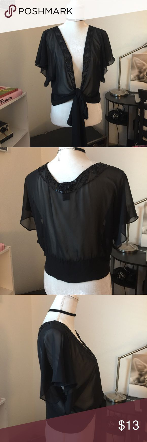 Lane Bryant Sheer Shawl/Top Lovely black Sheer Shawl with sequins, flowy sleeves. This would be great over a dress or even just a casual shirt or blouse. This is a super versatile piece. Never worn. Great condition. It doesn't matter if you're a size M or XL this would fit and look super cool. Lane Bryant Jackets & Coats