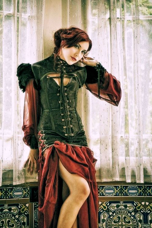 I love the colors and how the corset just goes right into the skirt & her hair color is amazing too.