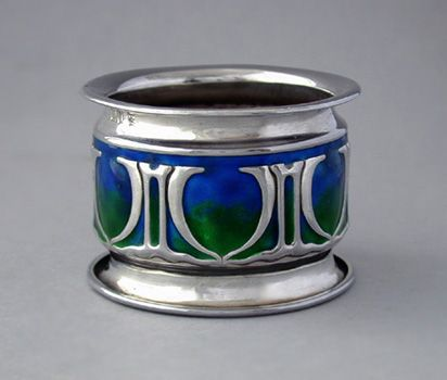 This is not contemporary - image from a gallery of vintage and/or antique objects. WILLIAM HUTTON & SONS Ltd. An Art Nouveau silver napkin ring with green and blue enamelling. One vacant cartouche for engraving.
