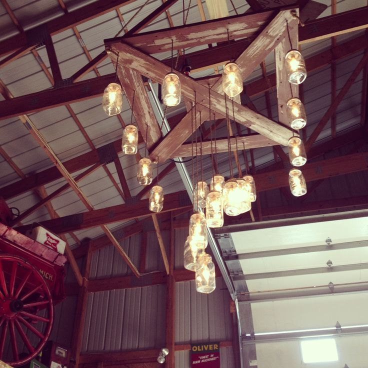 My uncle made a mason jar chandelier for my cousins wedding, I'm in love with it!!!