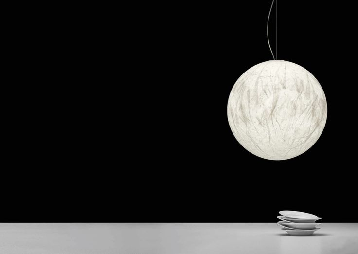Davide Groppi's Moon Suspension Light, is a fine and intricate pendant light that is made using Japanese paper. Moon was created and inspired by the idea of bringing the moon home. See more paper lights at LightForm.ca