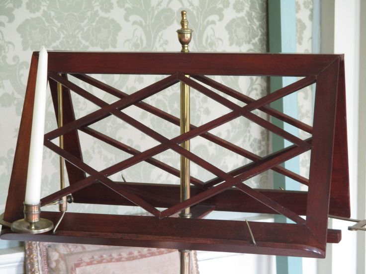 Mahogany music stand with candle holders.  Can be seen in the Long Drawing Room, Culzean Castle.