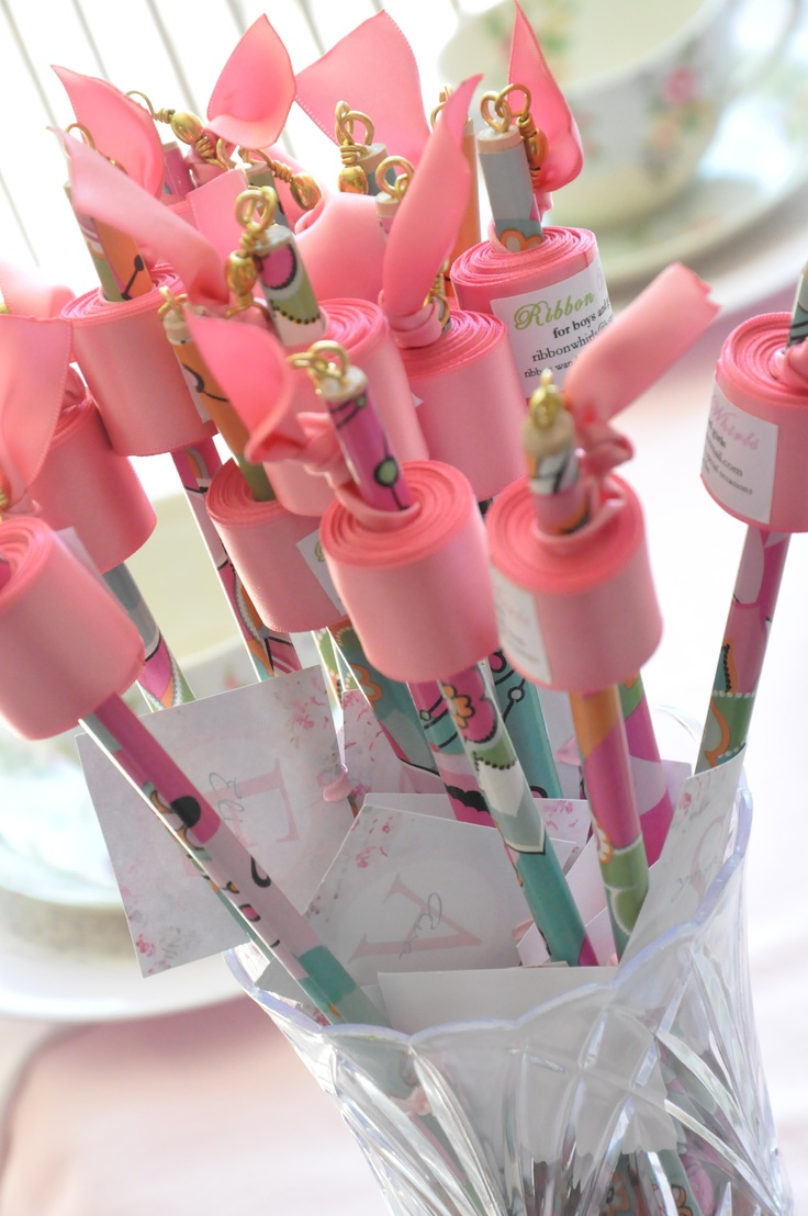 <3 Each individual person gets a pen and then writes a note on the paper for the B-day person or newly wed. :)