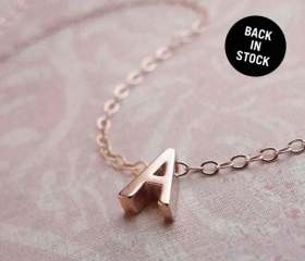 A tiny rose gold necklace with your initial, so pretty