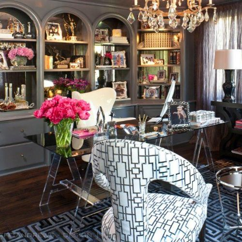 """The great color on the cabinets and built-in shelving unit    """"Benjamin Moore – Gray Shower 2125-30, semigloss lacquer.""""  Customizing the built-in:    """"We lacquered them and installed an antique mirror in the back of the shelves for some sparkle. We then added amazing new hardware."""