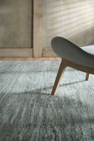 Julius - This incredible fresco design seamlessly takes inspiration from nature. Showcasing movement of land and water this design is a beautiful rug for your home.