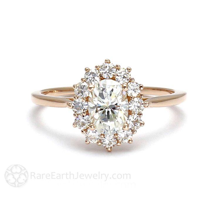 18K Cluster Moissanite Engagement Ring Oval Halo Forever Brilliant Moissanite Ring Conflict Free Diamond Alternative by RareEarth on Etsy https://www.etsy.com/listing/194958365/18k-cluster-moissanite-engagement-ring