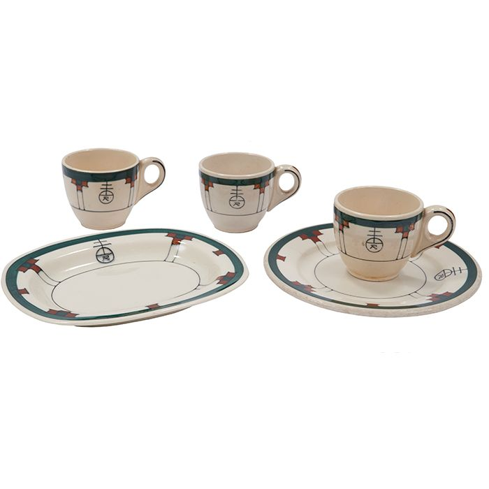 """The Roycrofters, Buffalo set, five pieces; bread plate, three demitasse cups, butter dish, East Aurora, NY, glazed porcelain, signed, butter plate: 7""""w x 5""""d"""