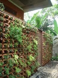 A vertical green wall built with bricks in a house project by architect Adi Purnomo in Jakarta, Indonesia