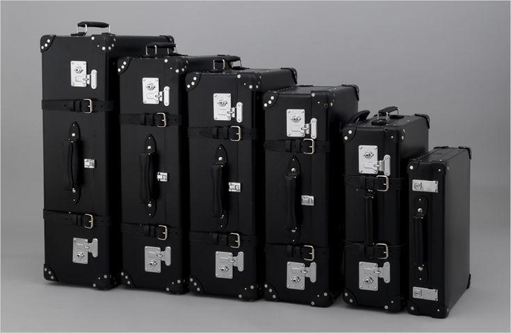James Bond Centenary Black Suitcases    The range is available as a 16″ Slim Attaché £725, 18″ Slim Attaché £775, 18″ Trolley Case £850, 21″ Trolley Case £950, 26″ Suitcase £995, 28″ Suitcase with Wheels £1,115, 30″ Extra Deep Suitcase with Wheels £1,165 and 33″ Extra Deep Suitcase with Wheels £1,220.