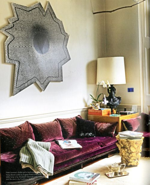 How about making wooden, decorative thought bubbles above where people sit On the couch, so it looks like people are thinking something.   Maybe Dry erase, or magnetic, so it be changed.