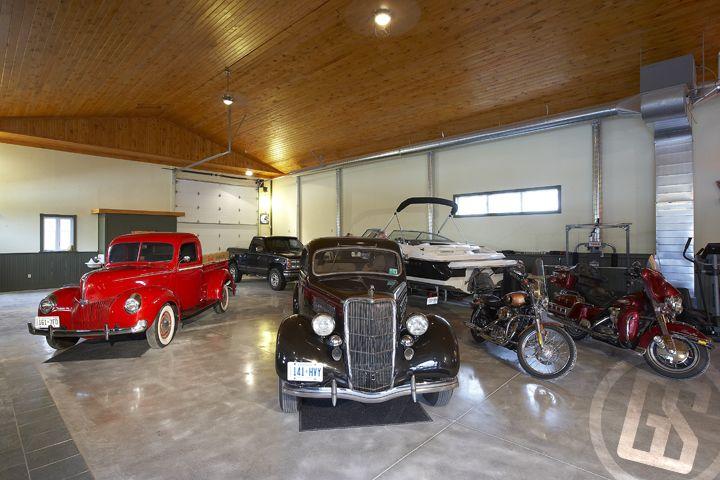 76 best garage interiors images on pinterest garage for Luxury garage interiors