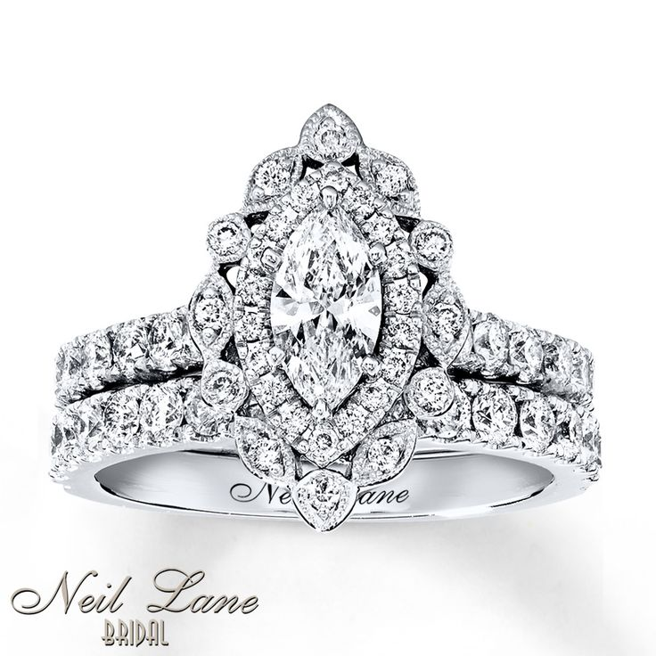 Vintage-inspired engagement ring from the Neil Lane Bridal® collection I am in love with this. Though I think I'd like a plainer wedding band.