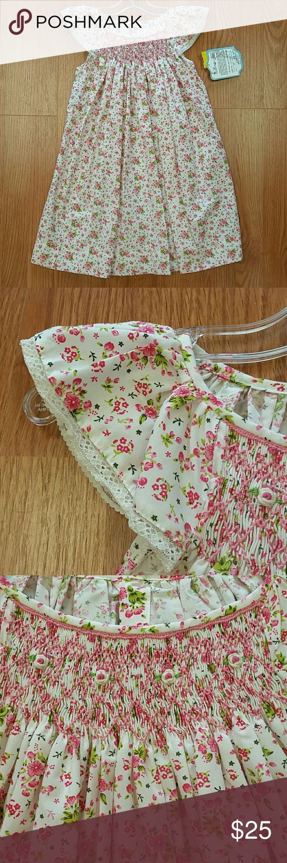 Remember Nguyen New with tags. Boutique brand. Light and delicate. Smocked top. Does run a little long in my opinion. Many of my customers have it hemmed, then let out the following year to get more use out of it. Remember Nguyen Dresses