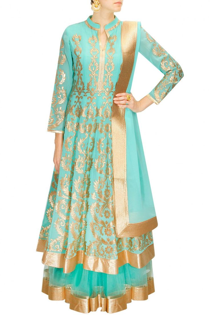 This sea green lehenga shirt is made in gorgette fabric having golden colour applique work. Bottom lehenga of this anarkali lehenga set is in net fabric with lu