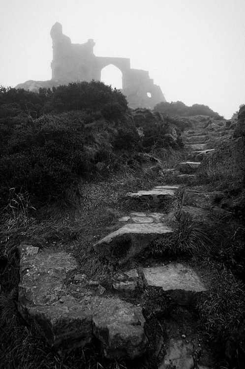 Mow Cop Castle is a folly built in 1754 by Randle Wilbraham as an elaborate summerhouse looking like a medieval fortress and round tower.