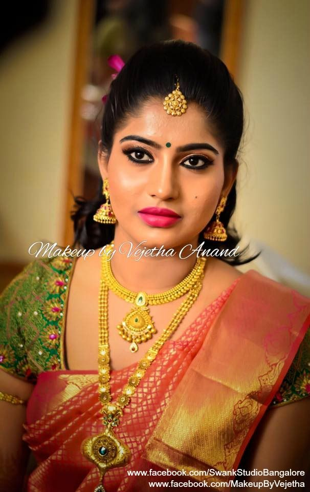 Pout perfect! Our bride Shilpa look beautiful for her reception. Makeup and hairstyle by Vejetha for Swank Studio. PHOTO CREDIT: Manish Ananda.  Traditional Southern Indian bride. Bridal hairstyle. Bridal jewellery. Pink lips. Eye makeup. Silk sari. Tamil bride. Telugu bride. Kannada bride. Hindu bride. Malayalee bride. Bridal Saree Blouse Design. Indian Bridal Makeup. Indian Bride. Gold Jewellery. Statement Blouse.  Find us at https://www.facebook.com/SwankStudioBangalore