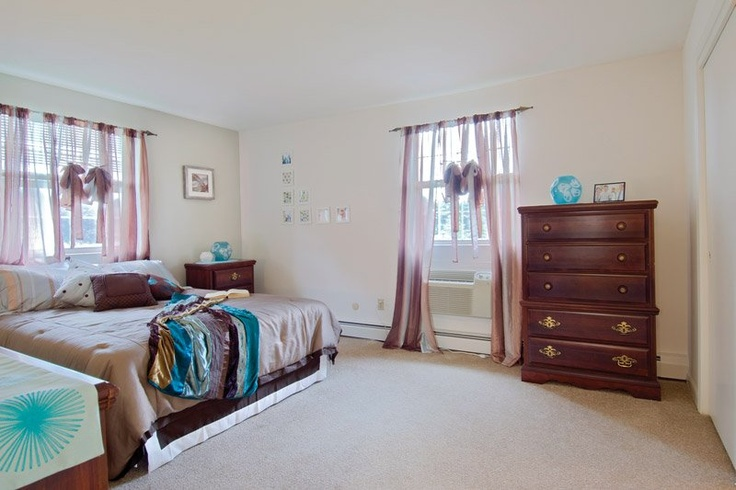 plymouth classic master bedroom features large windows and