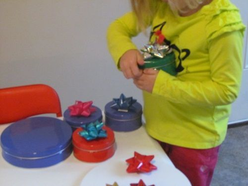 The children also enjoy a little holiday play by filling up empty tins with items from around the classroom and adding a magnetic bow or gift tag to give as pretend gifts…