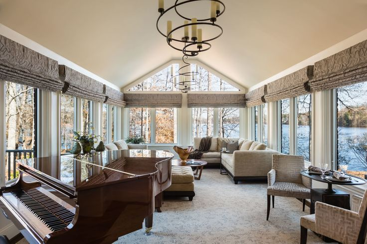 Sun room at this serene lake house in Greensboro. Designed by @rjohnstoninteriors. Photo by @catnguyenphoto.