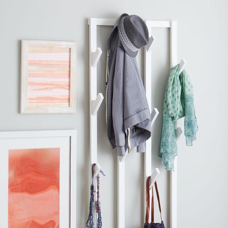 Space saving wall mounted coat rack