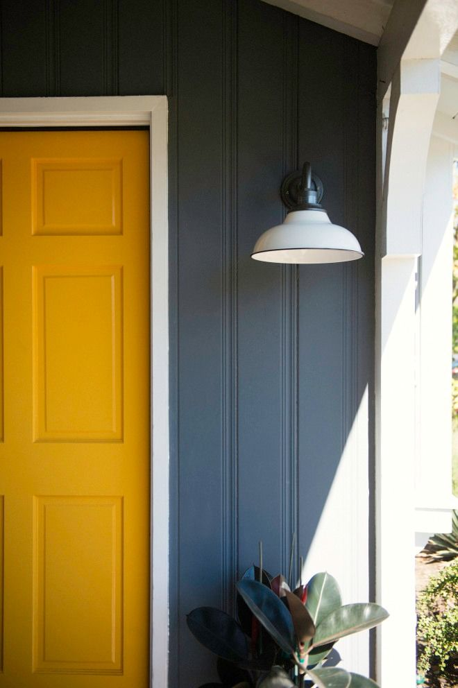 Front porch. Front porch lighting. Yellow door. Outdoor lighting. Gooseneck. Wall sconce. Rejuvenation Carson. White shade. White and black light. Indoor outdoor lighting. Front porch inspiration. Front porch decor. Blue and yellow house.