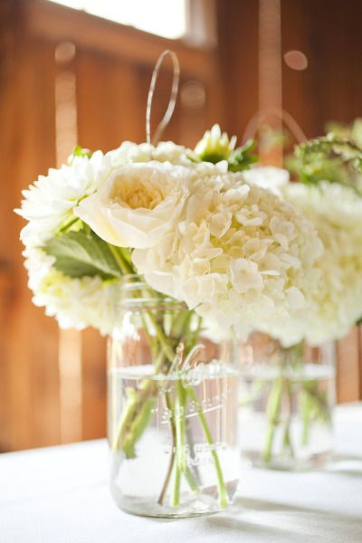 White flowers in mason jars-so pretty!