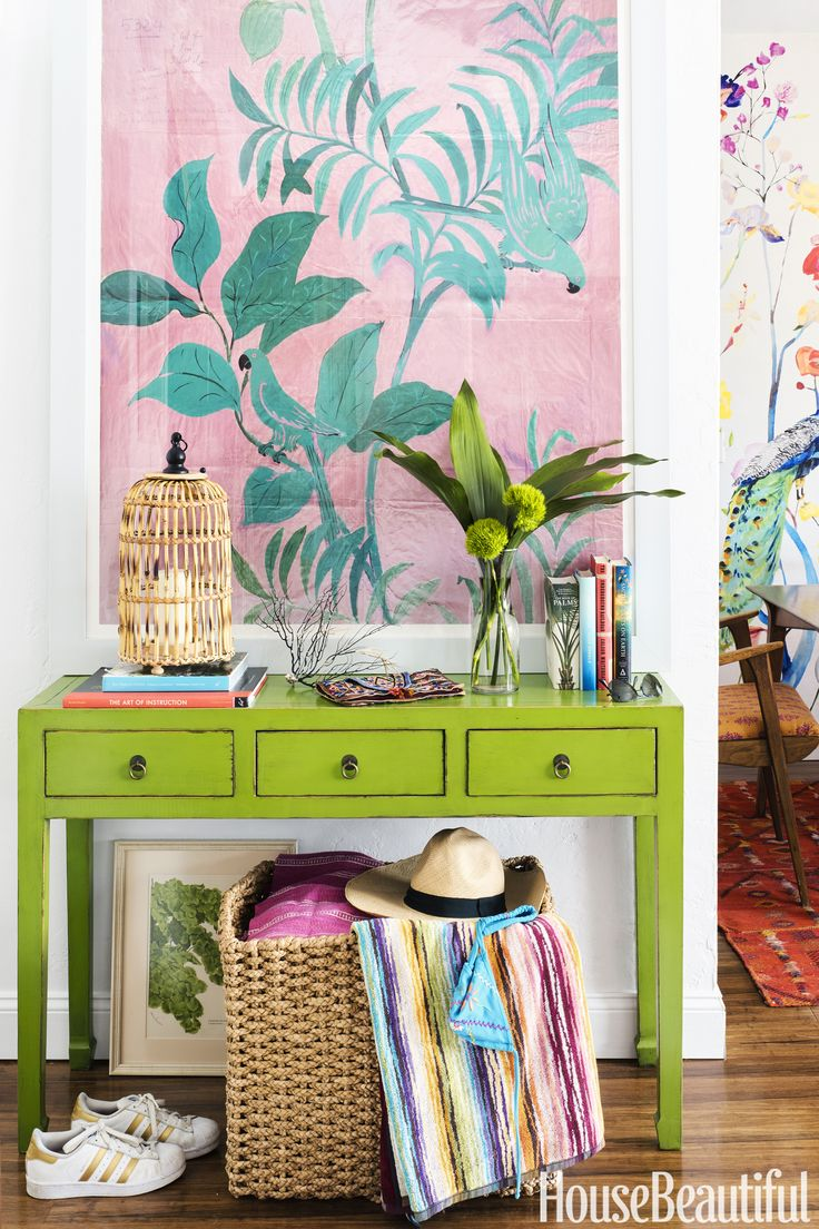 Entryway.  Designer Schuyler Samperton transformed her Florida apartment's petite foyer into an eye-catching vestibule with ample storage: A vintage console is a catchall for keys and dog leashes, while a West Elm basket holds beach towels