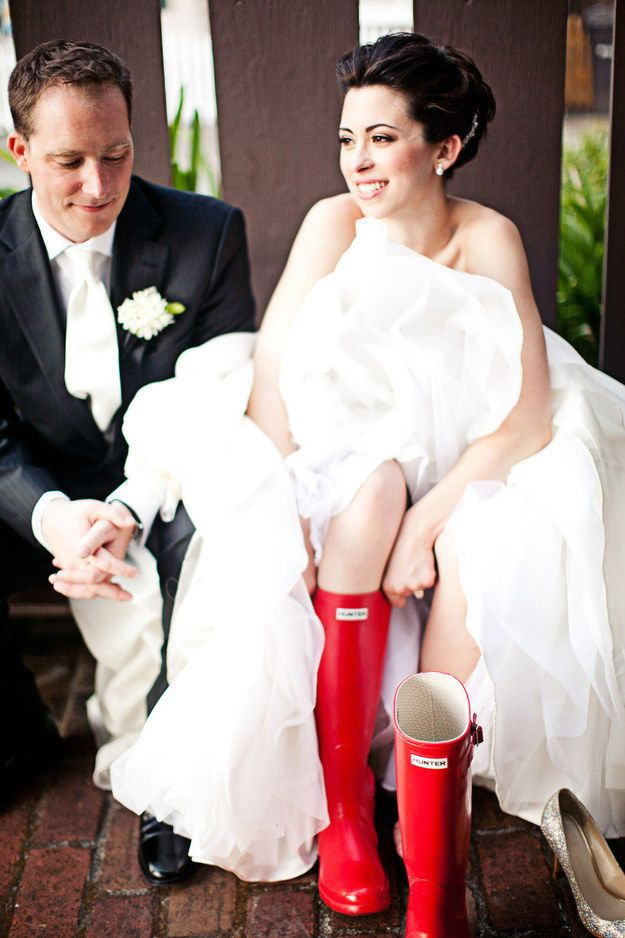 in case of rain, bring options and pull up your boots… | 24 Couples Who Didn't Let Rain Ruin Their Wedding Day