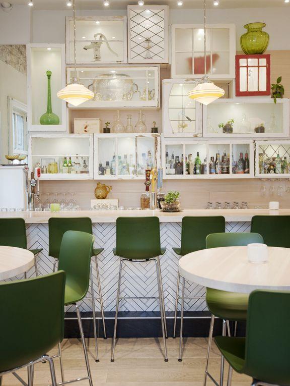 Heirloom- vegetarian restaurant in Vancouver- lighting fixtures- rustic box displays- green chairs
