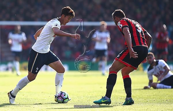 BOURNEMOUTH, ENGLAND - OCTOBER 22: Heung-Min Son of Tottenham Hotspur and Steve Cook of AFC Bournemouth compete for the ball during the Premier League match between AFC Bournemouth and Tottenham Hotspur at Vitality Stadium on October 22, 2016 in Bournemouth