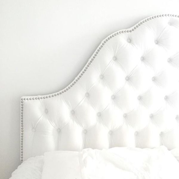 Make your bed feel like an instant oasis by adding a luxe velvet tufted and scalloped headboard.