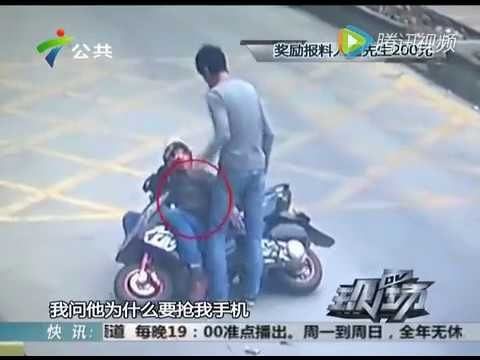 VIDEO: Truck driver stops motor scooter-riding phone thief with a flying kick | Weird News | ArcaMax Publishing