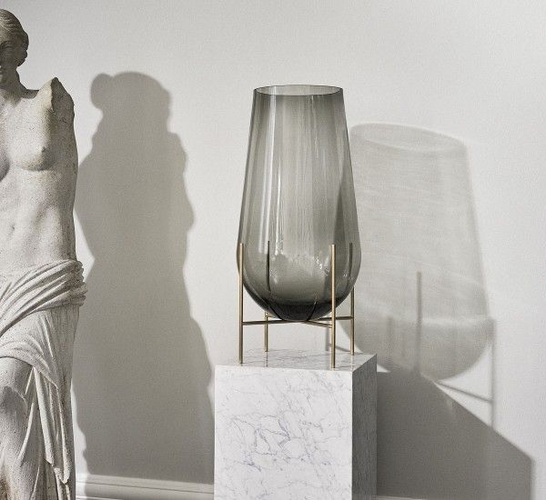 Designed by Theresa Arns for Menu, Echasse is a vase made in glass and solid brass - Sophisticated and classic design.