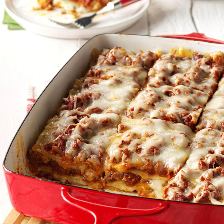 Traditional Lasagna Recipe -My family first tasted this rich, classic lasagna at a friend's home on Christmas Eve. We were so impressed that it became our own holiday tradition as well. I also prepare it other times of the year. It's requested often by my sister's Italian in-laws—I consider that the highest compliment! —Lorri Foockle, Granville, Illinois