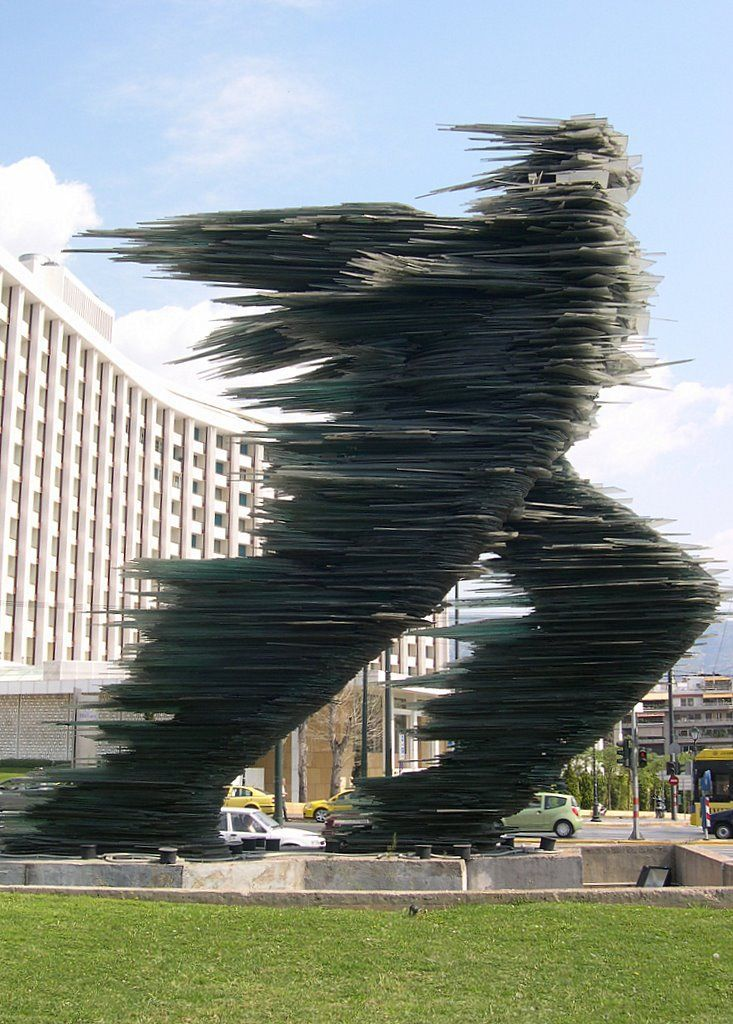 """Costas Varotsos """" The Runner"""" – in Athens. It is made entirely of dark green glass."""