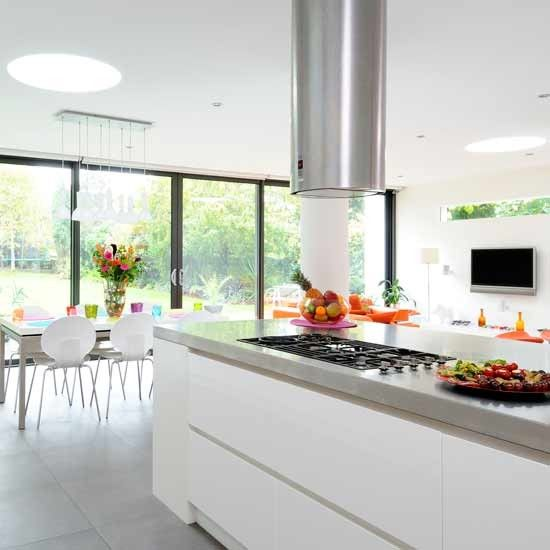 Open-plan kitchen diner. I  like the white and the cabinets under the hob