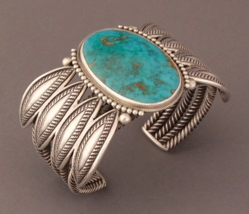 Perry Shorty Extra Large Bracelet of Blue Gem Turquoise flanked by silver balls and four repousse leaves on either side.
