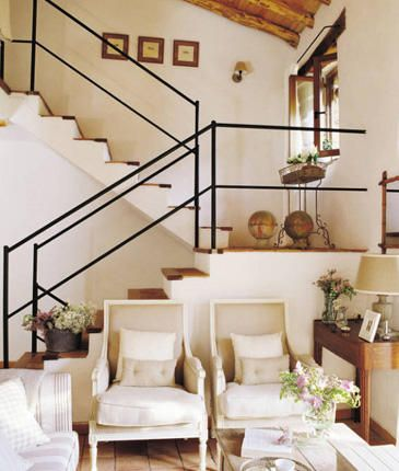 i love those chairs and the stair rails