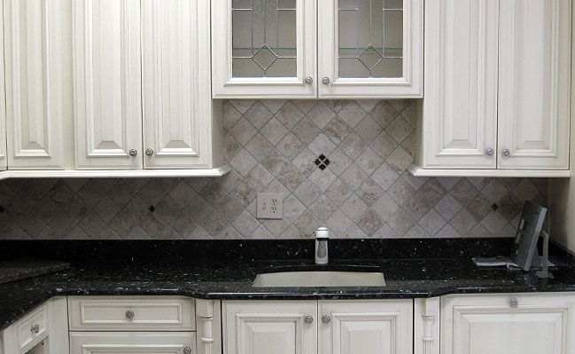 backsplash ideas for blue pearl granite | Diamond Pattern Ivory Antiqued Travertine Tile Backsplash