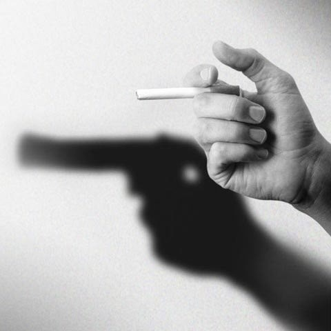 Gun Shadow- smoking kills. sigh I really miss smoking sometimes......don't worry I won't weaken :)