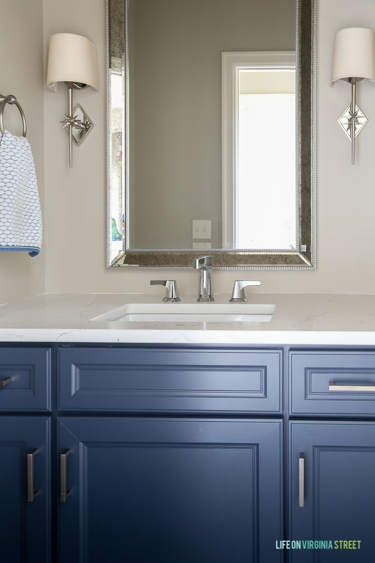 Love this bathroom renovation!  The blue cabinets with the chrome Delta faucet looks amazing!  #ad