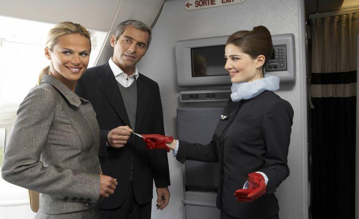 Flight Attendants Welcoming Passengers On Board Www