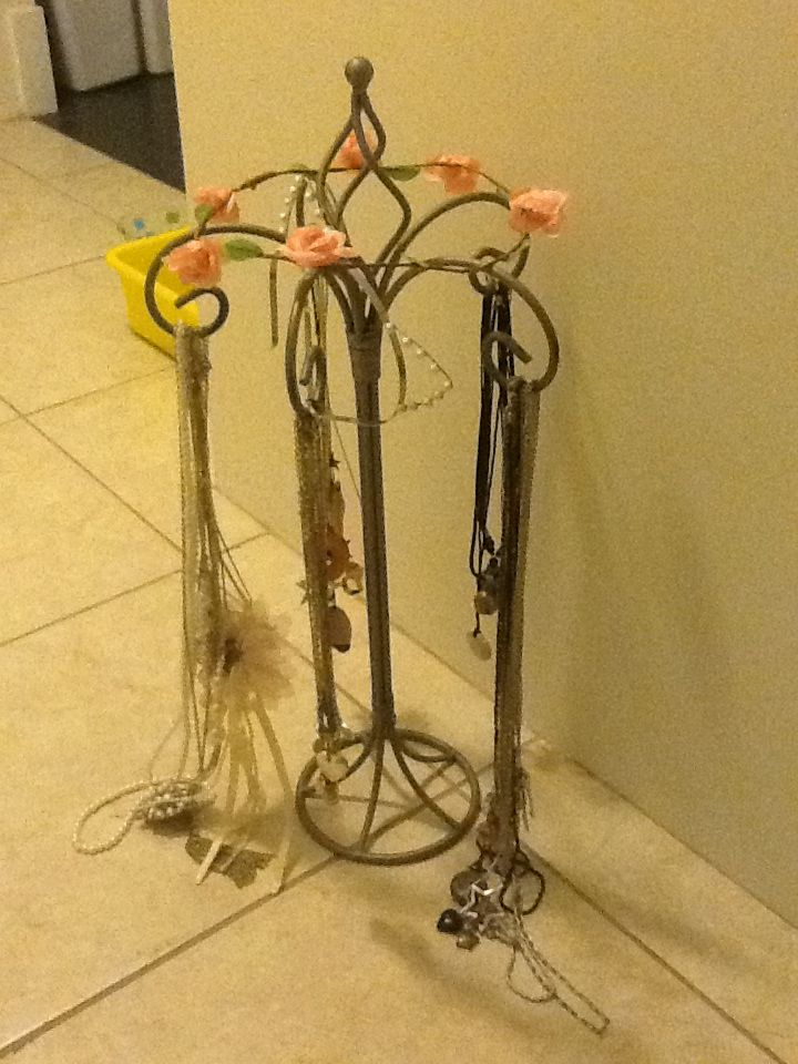 Use a candle holder to hand necklaces. Out a head crown on top and a hair band. Amazing and cute for ya room!!!