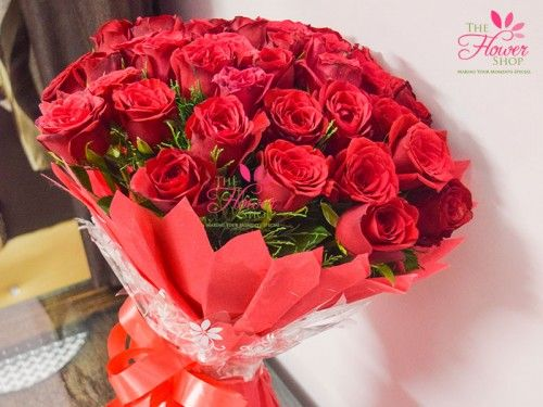 50 Beautiful Red Roses for every occasion wrapped in red paper and red ribbon helps you express your feelings.