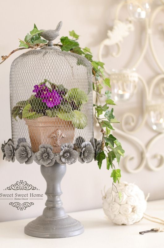 In love with this rose-lined pedestal and cloche!