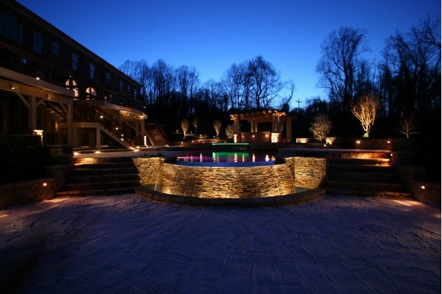 Love the subtle lights on the birches, Zen garden, and stacked stone fountain.