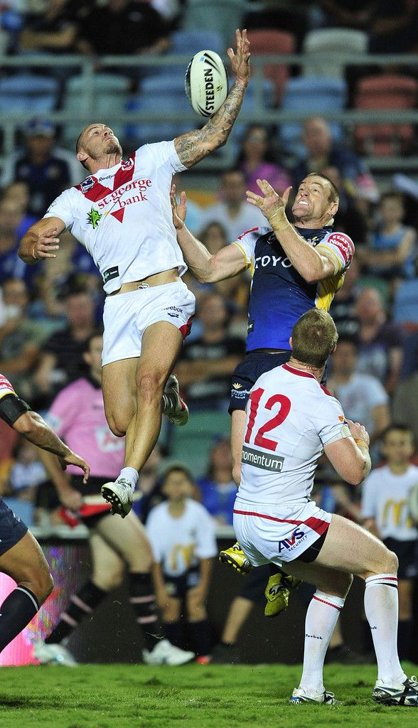 Matt Cooper of the Dragons contests a high ball with Brent Tate of the Cowboys during the round nine NRL match between the North Queensland Cowboys and the St George Illawarra Dragons at Dairy Farmers Stadium on May 4, 2012 in Townsville, Australia. #NRL #Rugby #Sports