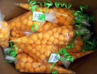 From Blooming Where I'm Planted: cheese balls in an icing bag look like a carrot for an Easter treat